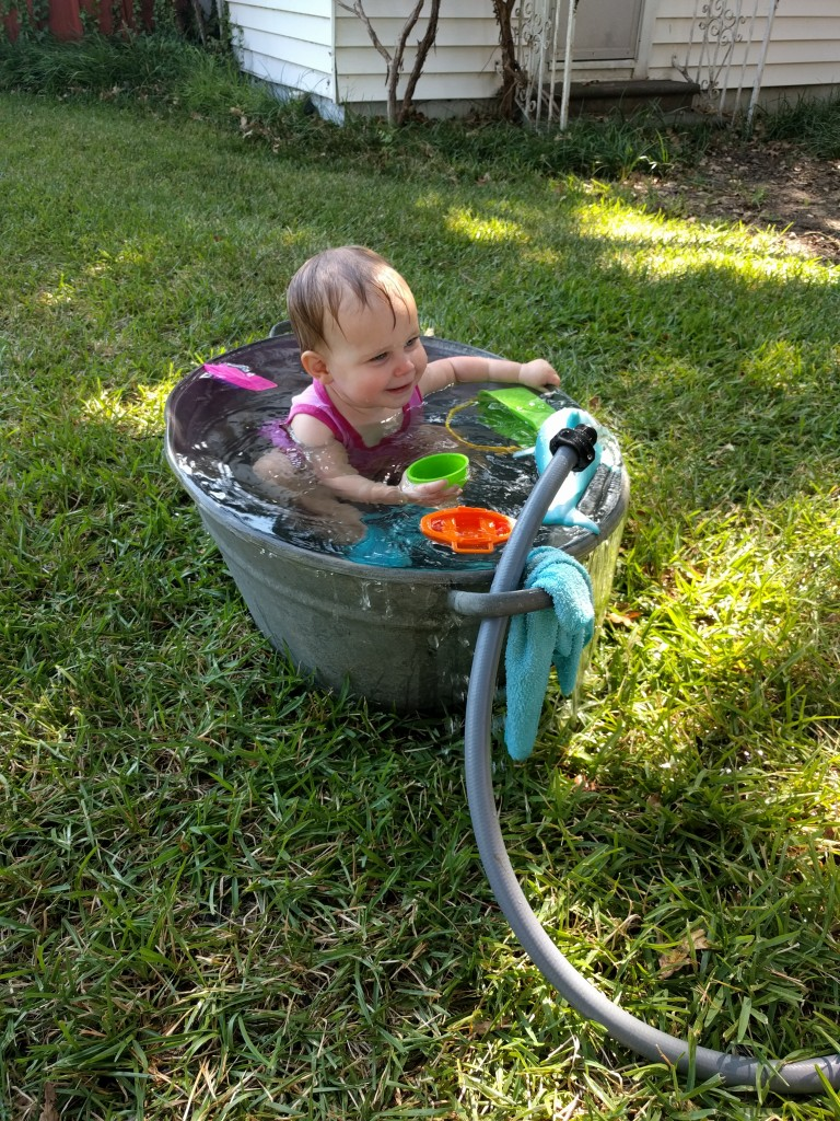 She had the time of her life in this little wash basin with toys and a hose.