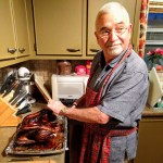 Granddad carves duck